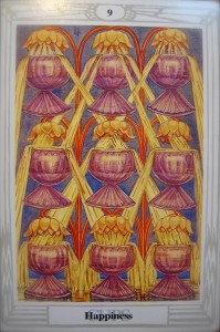The Nine of Cups from the Thoth Tarot deck.