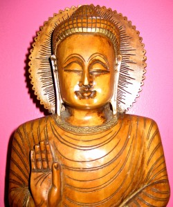 We must do the freeing ourselves... - Photo of carved wooden Buddha by Jan Ketchel