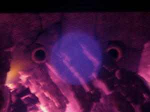I noticed this face at the back of the wood stove... with its glow on! - Photo by Jan Ketchel
